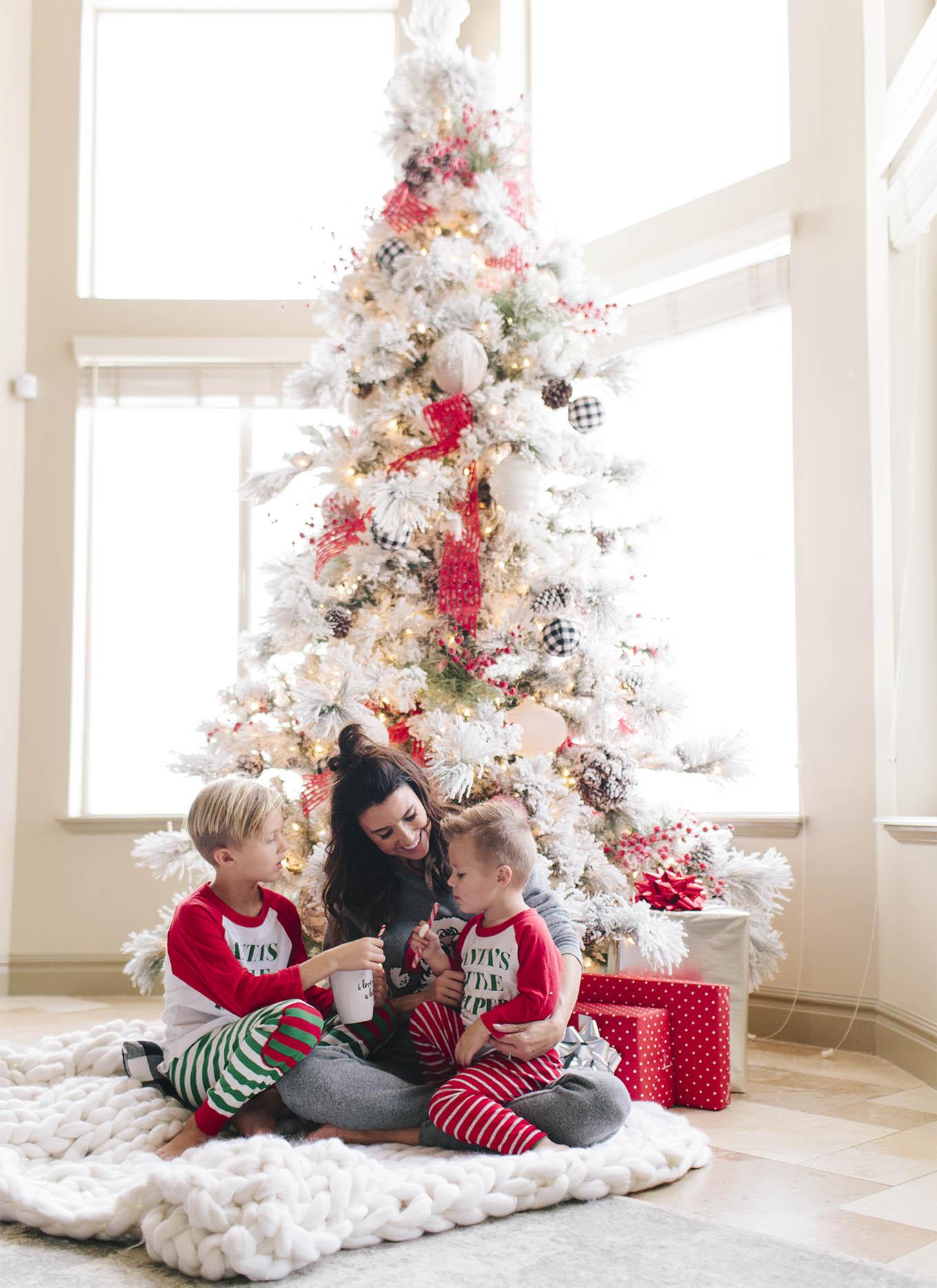 family under christmas tree