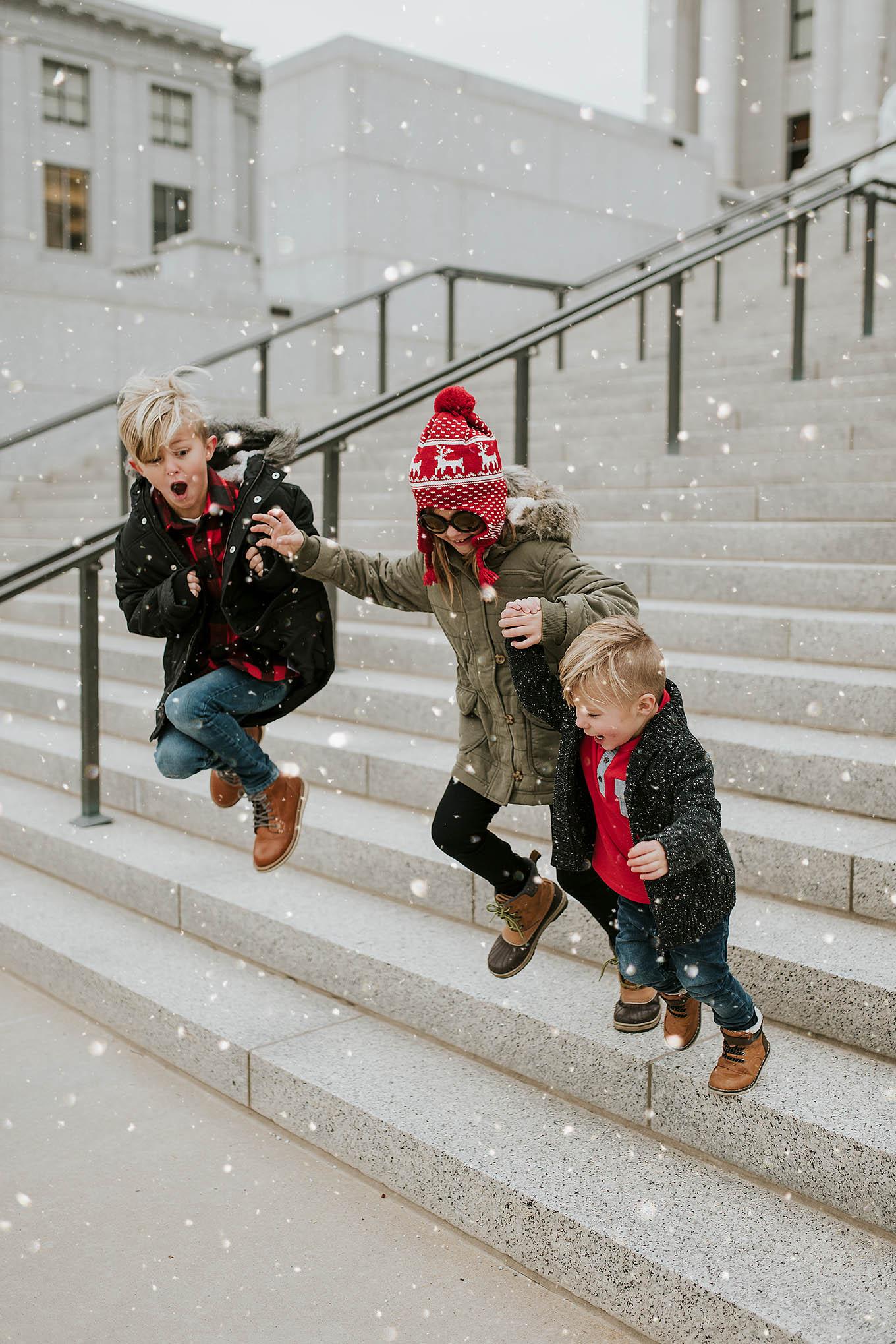 kids jumping snow