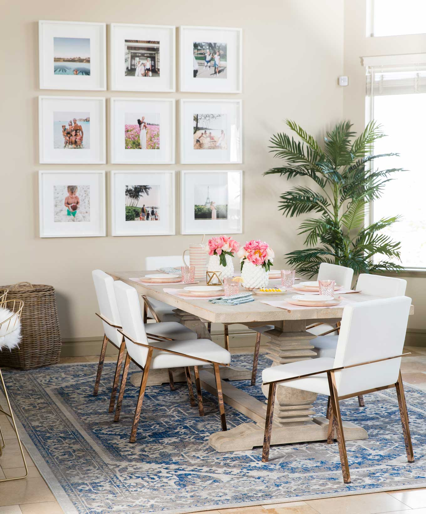 This rug placement leaves enough room for the chairs around the table to move! It's a perfect size for the dining room table and mimics the size and shape of the table, pulling the whole room together.