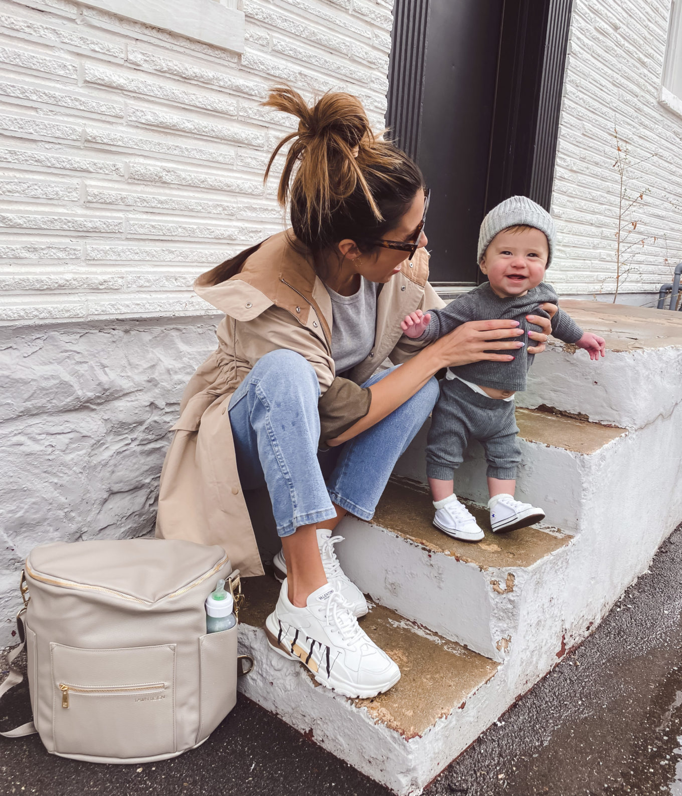 christine andrew and baby with travel bag and diaper bag